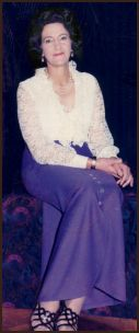 Phyllis James wearing a maxi skirt with a ruffled or frilly blouse. 1971