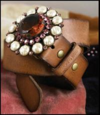 This Plumo Vintage style belt in chestnut brown leather is available in two sizes and can be bought online from Plumo at �109.  With its Swarovski crystal set buckle, it is encrusted with ivory fashion pearls and sparkling pink Swarovski crystals.
