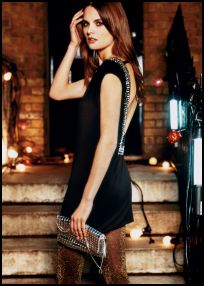 This black, embellished low back dress. is also from Warehouse and is �55/�85. The Lurex tights add a festive touch.