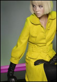 Dorothy Perkins - Yellow belted coat �60/�95, Black long leather gloves �20/�30. This belted wool coat in ochre makes a striking impact when worn with long black leather gloves