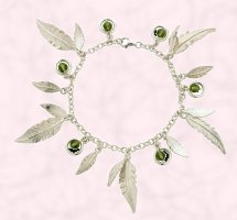 Curteis Jewellery 2007 contemporary style sterling silver ladies feather charm bracelet.from the 'feathers' collection within the 'inspired' jewellery range by Curteis Ltd. Semi precious beads comprise: Olivine Swarovski crystal. RRP: �70.