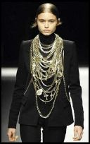 Givenchy skinny trousers, severe jacket and lots of metal hardware, crucifixes and chains.