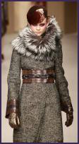 Pollinini winter wool and fur collar coat. Brown leather cuff and belt trim.