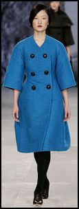 Shapely curved cartoon blue, cotton and silk boucle coat, by Aquascutum - �2500.