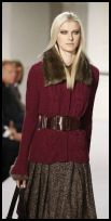 Oscar de la Renta cable knit cardigan with fur collar.