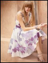 Oasis Spring Summer 2008 Campaign - white dress with full skirt and lilac print pattern.