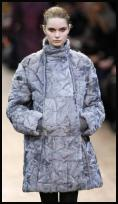 Akris catwalk coat with kangaroo pockets.