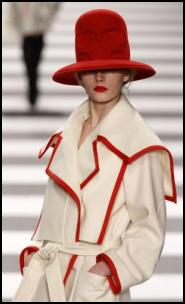 Designer Cream Coat with Red Trim Binding.