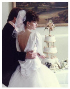 1986 - Backless wedding gown - cutting the cake.