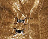 fabric fashion, Gucci skin - Finishes given to many textiles especially leather includes burnishing it with a metallic cast