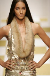 Hobeika gave gold lace a modern turn in a bell-shaped dress with geometric-cut sheared-mink fur trim