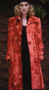 This wonderful red velvet coat by Avoca Anthology is covered in ribbon circular sunburst decorative embellishment arrangements.