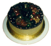 Picture of a Christmas cake decorated with various glace fruits.