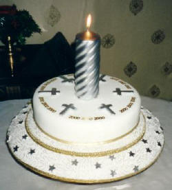 Picture of a millennium cake with sugarcraft crosses.