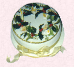 Picture of a Christmas cake with sugarcraft holly wreath.