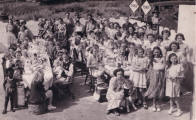 Carnival picture - sitting and eating at the carnival party in 1951. Costume history and fashion history 1950s.