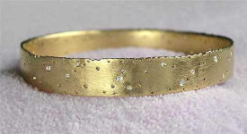 Love2have.co.uk diamond bangle in 18ct gold.