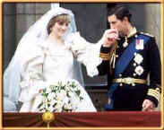 Picture of Princess Diana and Prince Charles on the balcony at Buckingham Palace as he kisses her hand on their wedding day. New romantics fashion history 1980s.