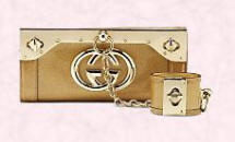 Gucci gold clutch bag and wristlet