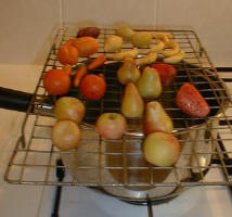 Setting the Food Powders on Marzipan Fruits with Steaming Saucepan