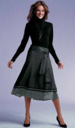 A similar soft look from NEXT Directory. Deep Waist Roll Neck Sweater in Black is �14.99.  No. 102-207-X38.  Grey Circle Skirt is �29.99.  No. 109-809-X38.
