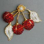 Fashion-era picture of costume jewellery cherries crystal brooch from Glitterbug