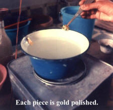 Each cleaned/shining piece is then gold polished at places where the base enamel is not there.