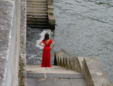 Lady in red on the steps at the banks of the River Sine in Paris Summer 2006
