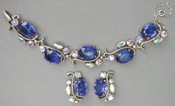 Fashion-era picture of Schiaparelli costume jewellery blue toned pieces from Glitterbug