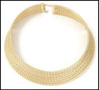 Cleopatra style collar in gold.
