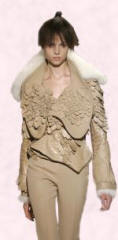 Givenchy - Clothes with reptilian leather effects helped create a warrior women look - 2007 Fashion History.