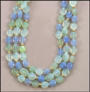 "Totally enchanting pastel-tinted Olive, Sea Foam, & Blue 17"" Chalcedony necklace with 14kt gold roundels and toggle clasp."