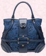 Blue suede and perforated leather butterfly bag is by Alexander McQueen. This bag is available from Browns Fashion of South Molton Street, London, UK or their online site at �1015