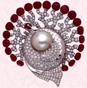 Luxury bespoke jewellery - The H�ra clip is white gold set with diamonds, Burmese ruby spheres and all adorn a natural, button shaped mabe pearl (17.92 carats).  Price on application to Van Cleef & Arpels.