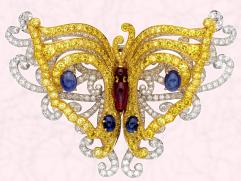 The Eph�m�re clip is made of of yellow and white diamonds, rubies and sapphires and is from Van Cleef & Arpels.
