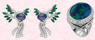 In the Serenit� earrings above left, designers have reproduced the pure lines lines of the dry oriental gardens within the flowing curves of diamonds. These lines are studded with fascinating cabochon star sapphires, imitating smooth boulders. A few marquise-cut emeralds represent the leaves of the maple, a highly symbolic tree in Japanese gardens. Beside the earrings, the Nuit d�Orient ring features a magnificent black opal (22.96 carats).