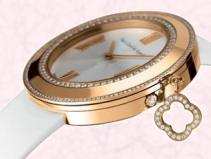 This Van Cleef & Arpels watch has a diamond Alhambra charm. The Alhambra motif is frequently used as a feature of timepieces.