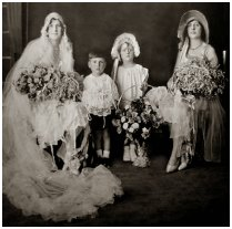 Fashion history bridal group - bridesmaid flower girl, page boy and matron of honour bridesmais wearong hat. C1928 to 1929.